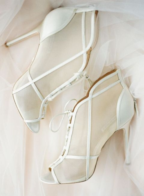 white sheer wedding booties with peep toes and leather straps look bold, chic and are a modern take on vintage