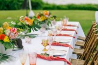 a cheerful tropical wedding tablescape
