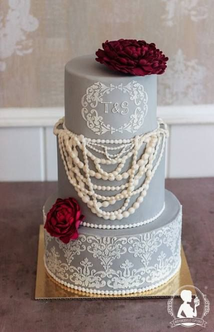 a vintage-inspired grey wedding cake with sugar lace and sugar pearls plus fresh burgundy blooms on top