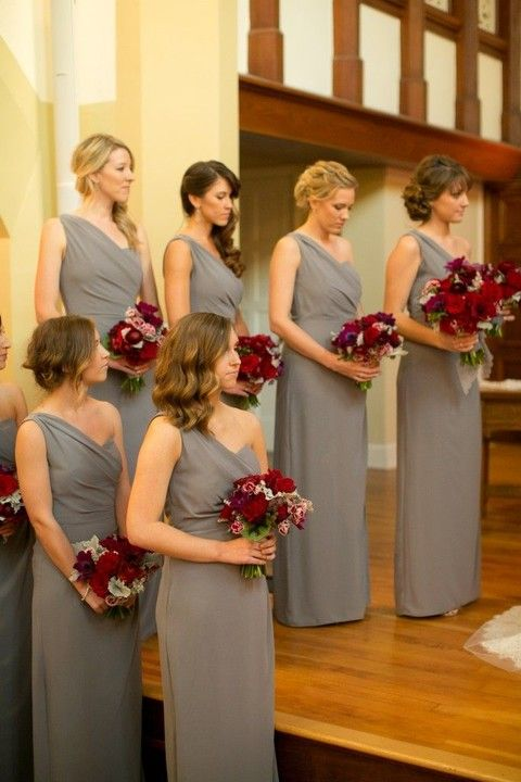 one shoulder grey maxi bridesmaid dresses and bold red bouquets are an amazing combo for a winter wedding