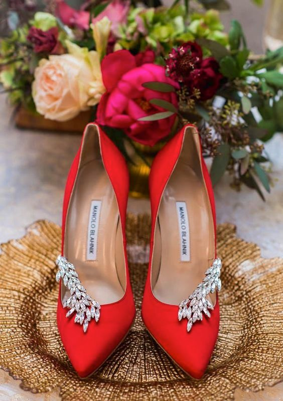 red suede embellished shoes by Manolo Blahnik for a sparkly touch will finish off your bridal look