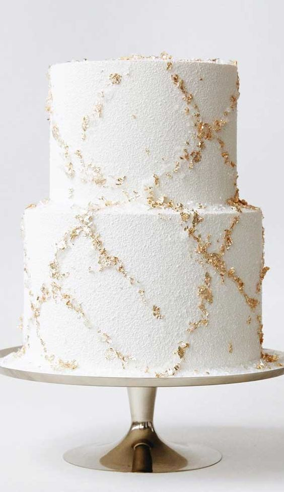 a beautiful wedding cake with gold leaf is a very stylish and beautiful idea to rock for a winter wedding
