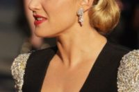 a bobby pinned curly hairstyle is a sophisticated and chic hairstyle for a vintage-inspired bride