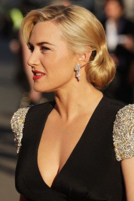 a bobby pinned curly hairstyle is a sophisticated and chic hairstyle for a vintage inspired bride