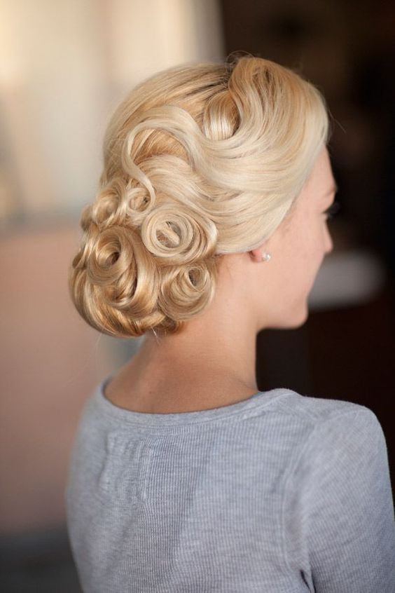 a catchy pin curl vintage low updo looks lovely and bold and catches the vintage feel