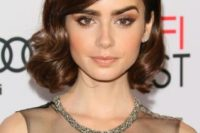 a chic vintage wavy hairstyle with a side fringe and a small volume on top looks very stylish
