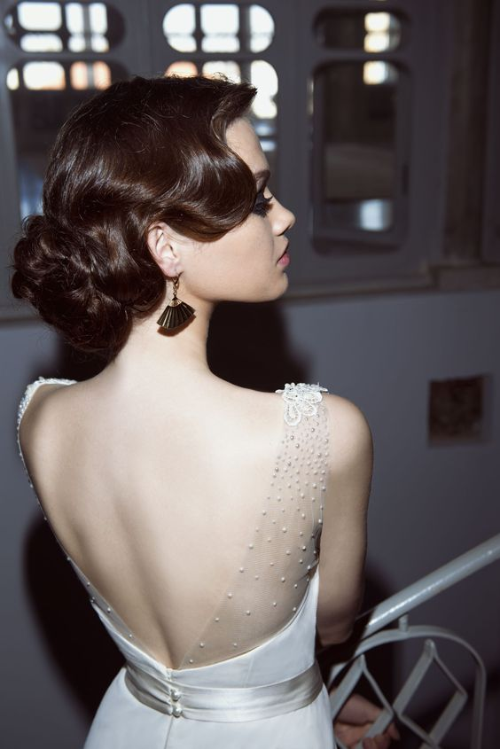a fantastic vintage wave updo with a low twisted bun looks ultimately refined and very chic