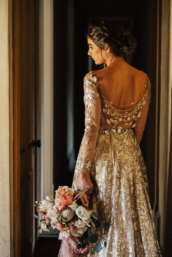 a gold and white floral wedding dress with layered back necklaces with baroque pearls and rhinestones is a gorgeous idea