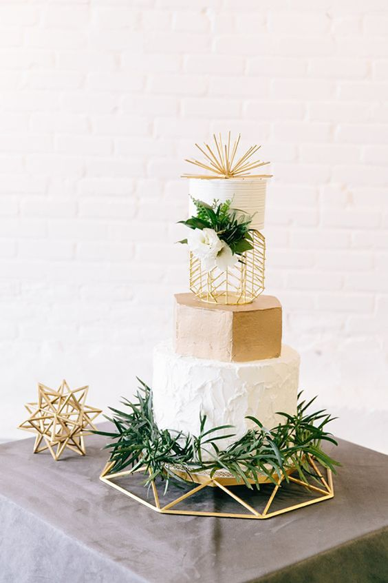 a cool modern wedding cake design in white and gold