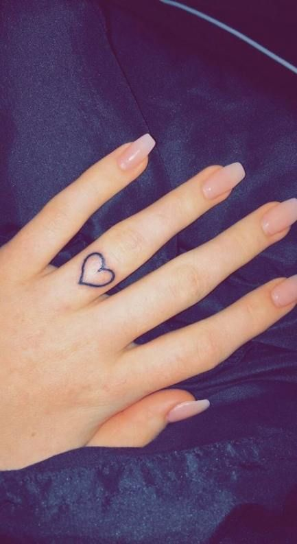 a heart-shaped tattoo on the ring finger will substitute any wedding ring and will look stylish
