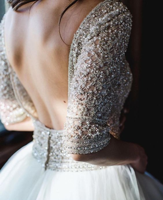a heavily embellished and embroidered silver wedding dress bodice and short sleeves is very refined