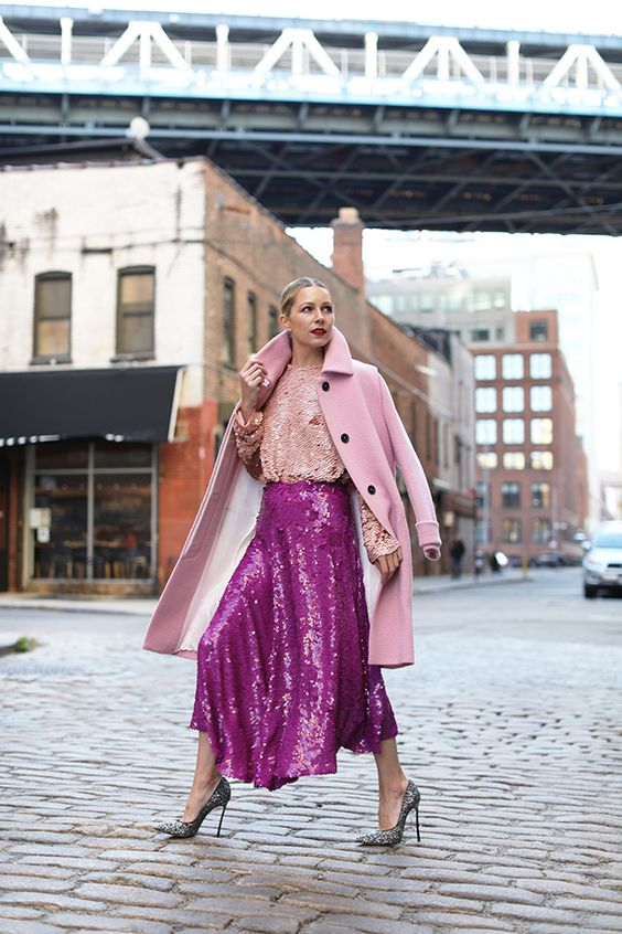 a hot pink sequin A-line midi asymmetric skirt is a bold and very glam idea to try