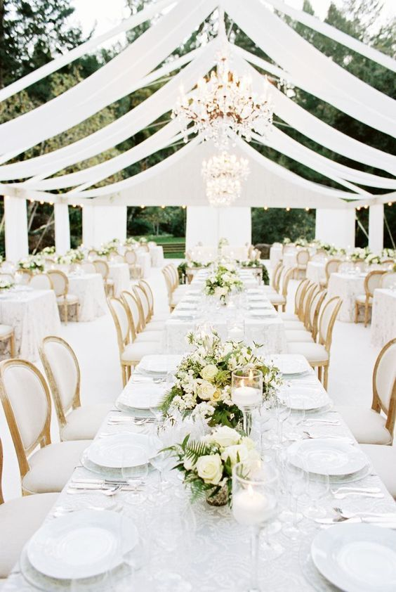 meadowood; meadowood wedding; napa wedding; napa valley wedding; vineyard wedding; northern california wedding; california wedding; britt chudleigh; a savvy event; nancy liu chin; outdoor wedding; outdoor reception; fabric roof; chandeliers; wooden chairs with white upholstery; white and green florals; table garlands of greenery and florals