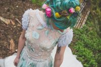 a mint green A-line wedding dress with lace appliques and embroidery plus an embellished sash for a daring look