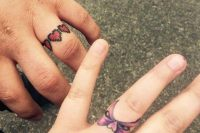 a pixel heart ring and a bow ring on the ring finger are a lovely tattoo idea for couples, make them on your wedding day