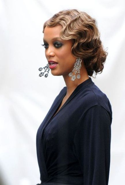 a retro low updo with waves is 20inspired and very chic and bold, add vintage makeup and go