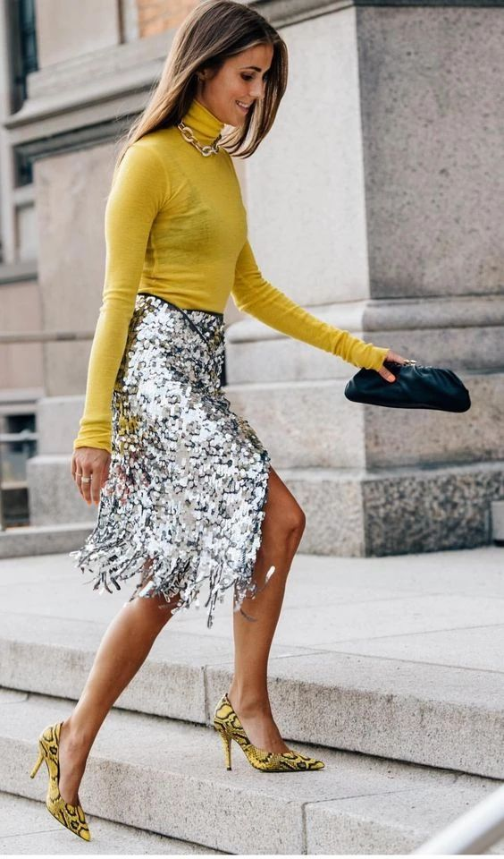 a silver sequin midi wrap skirt with fringe is a catchy and interesting take on a usual piece