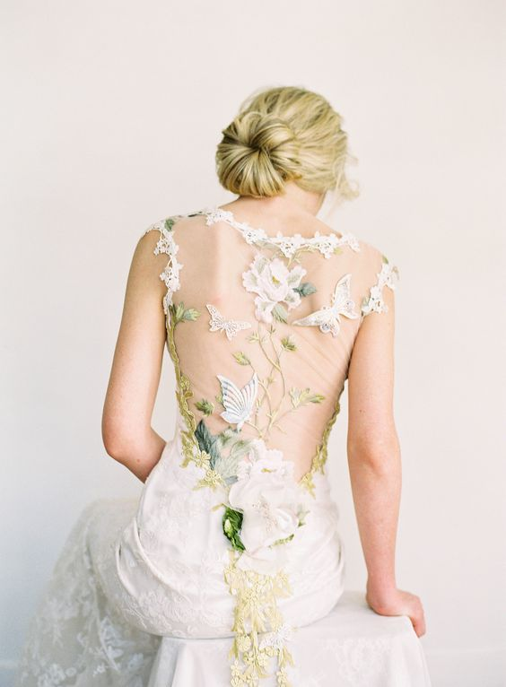 a stunning sheath wedding dress with gorgeous floral and butterfly appliques on the sheer back and green embroidery
