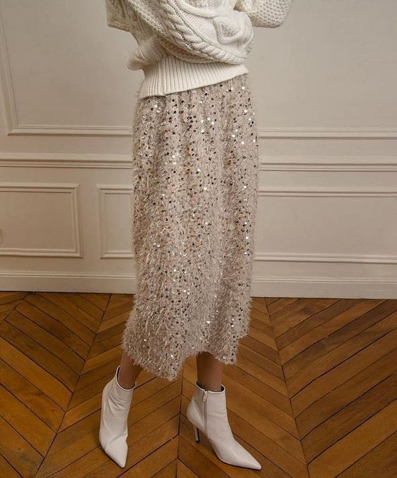 a white fluffy A-line midi skirt with some sequins looks very modern, glam and girlish