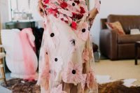 an A-line fully embroidered and applique floral wedding dress and matching mules for a bold look