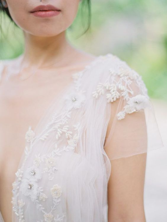 delicate floral appliques with beading and embroidery will make your wedding dress more eye-catchy