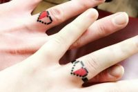 fun pixel heart wedding ring tattoos are bold and fun and will match many couples