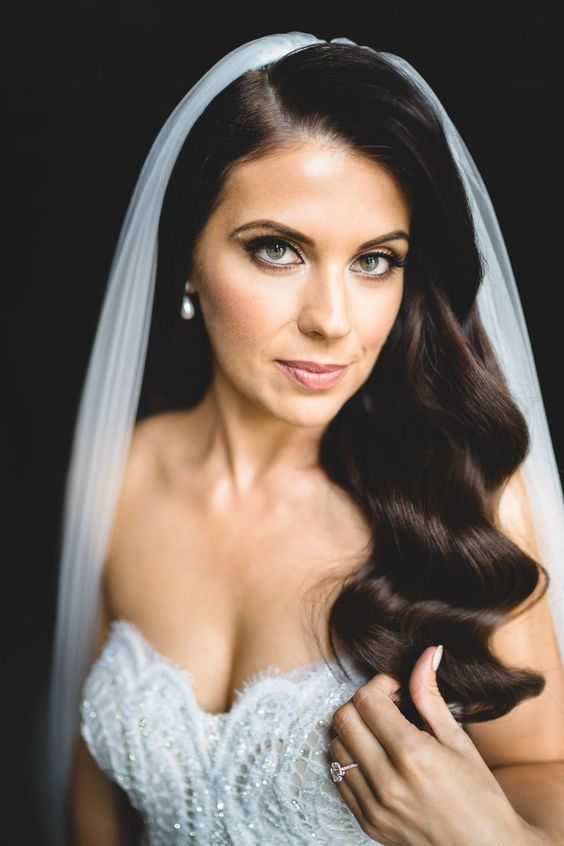 long dark vintage waves accented with a long veil look very elegant and refined