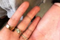 mini heart tattoos on the backs of the ring fingers are great for a modern couple and they aren't in your face