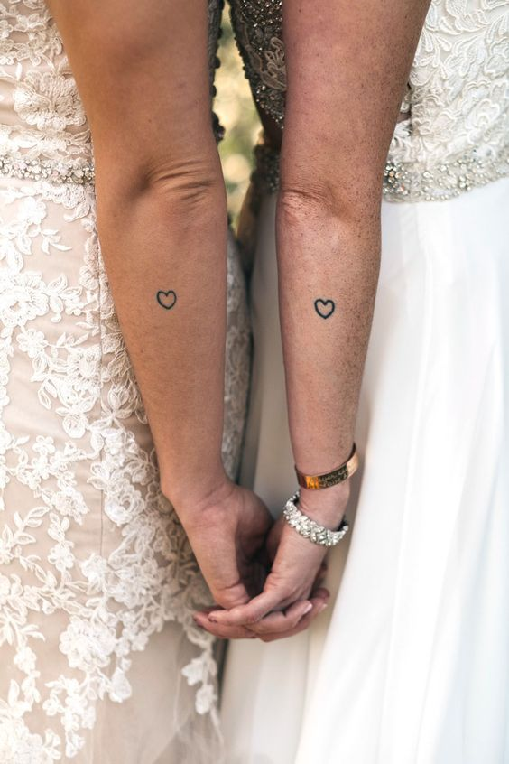 simple heart tattoos on the forearms are a timeless idea that will show you as a couple if they are matching