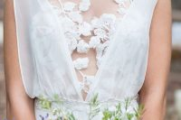 strategically placed floral lace appliques create a unique and very delicate bodice for a wedding dress