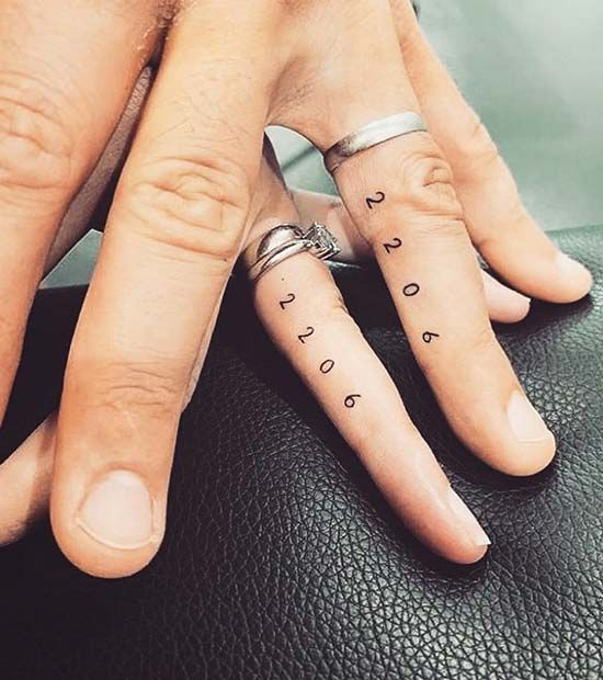 stylish wedding date tattoos made with usual numbers and placed on the sides of the fingers