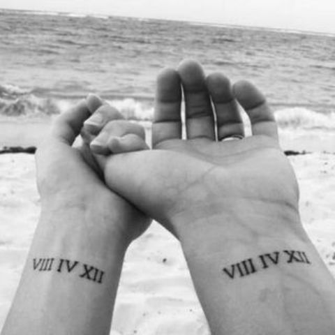 your wedding date in Roman numbers placed on the wrists are veyr cool and stylish matching tattoos