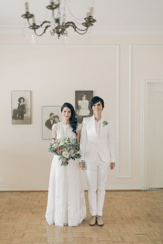 a creamy bridal pantsuit with a white top, nude shoes and a succulent boutonniere
