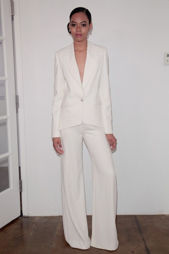 a stylish minimalist pantsuit with palazzo pants and a cutout blazer with long sleeves for a chic look