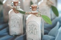 bottles with sea salt decorated with greenery will fit not only beach weddings but coastal spring too