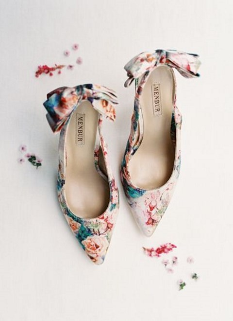colorful floral shoes with bows on the backs are chic and bright and will do for a spring or summer wedding
