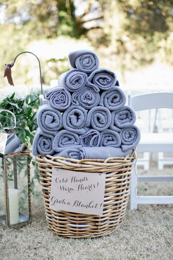 offer your guests pashminas or blankets as favors and for the outdoor ceremony if it's gonna be chilly