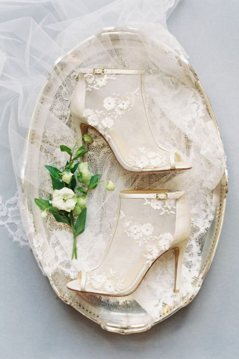 sheer wedding booties with peep toes, buckles and floral appliques and beads are fashion-forward