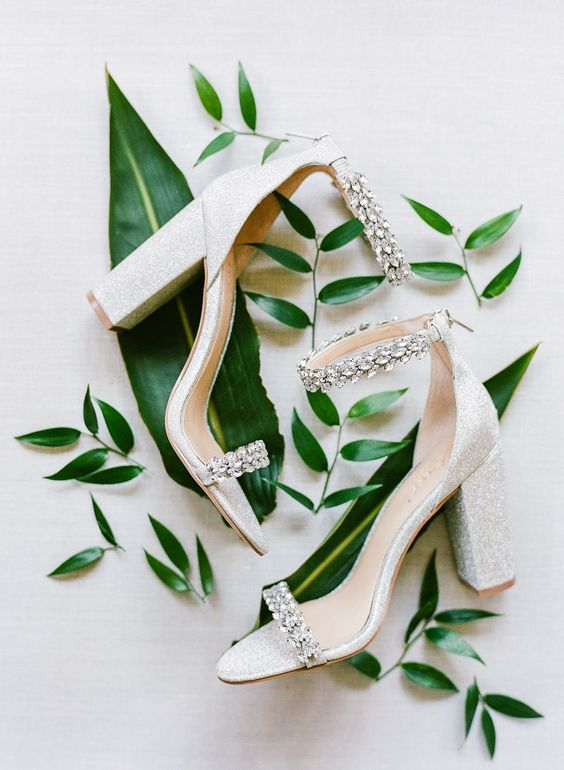 shiny white wedding shoes with embellished tops and ankle straps are amazing for a glam bride