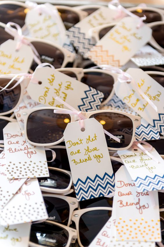 sunglasses with mini tags are always a good idea if it's gonna be sunny at your outdoor ceremony