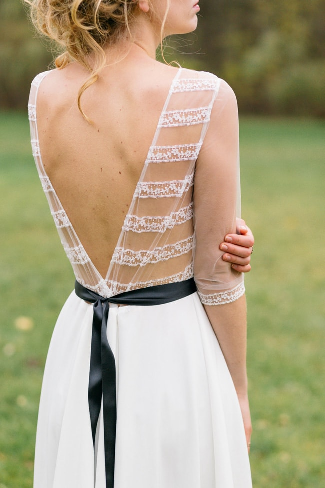 a beautiful A-line wedding dress with a sheer lace bodice and back, with a V cutout on the back and illusion sleeves is dreamy