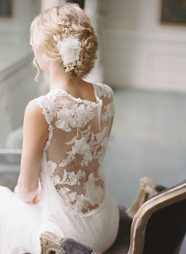 a beautiful lace fitting wedding dress with an illusion back with floral appliques is a statement solution with a tender and soft feel
