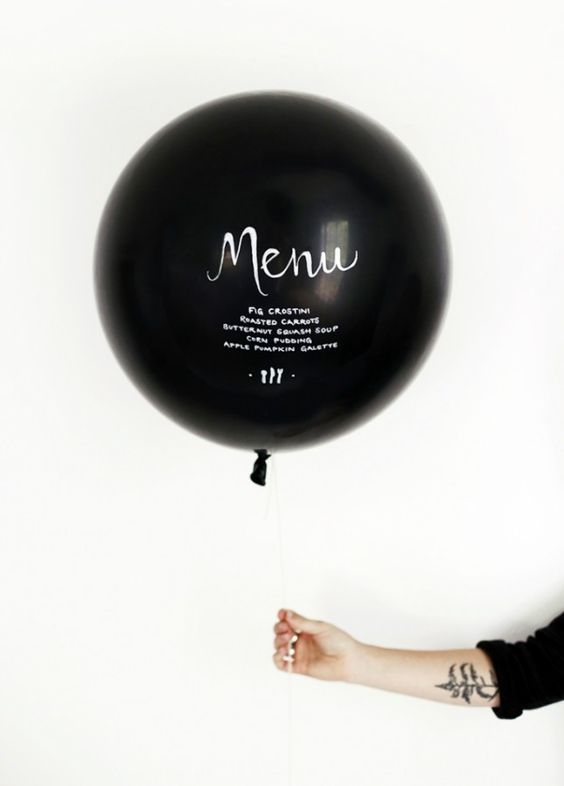 a black balloon with white letters is a creative and fun modern idea for a fresh and modern feel