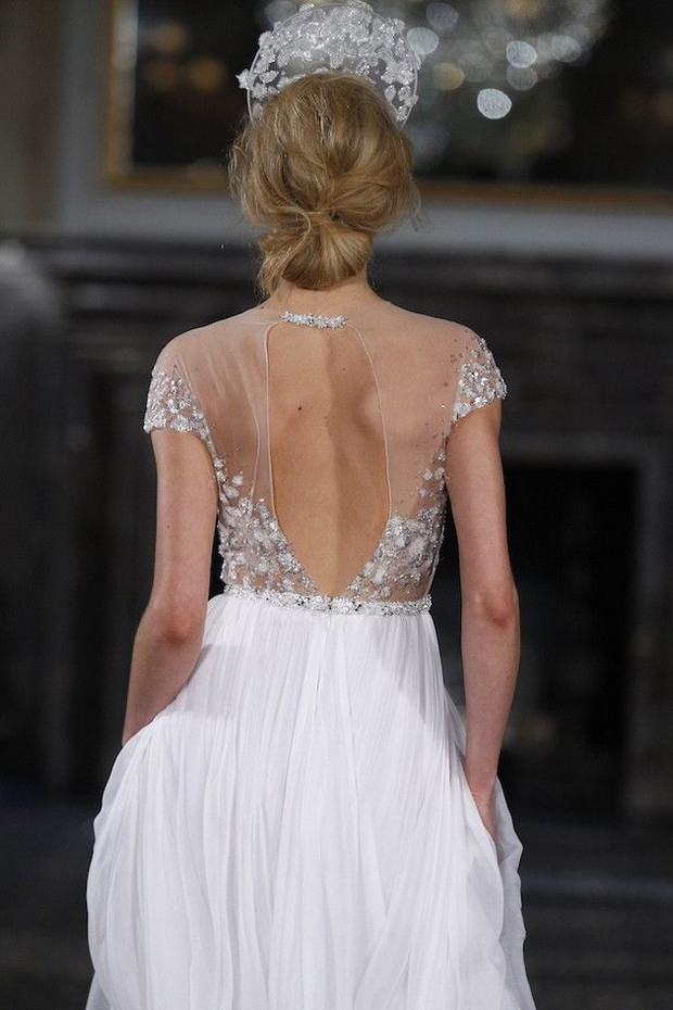 a breathtaking A-line wedding dress with an embellished bodice and cap sleeves, a pleated skirt and an illusion cutout embellished back