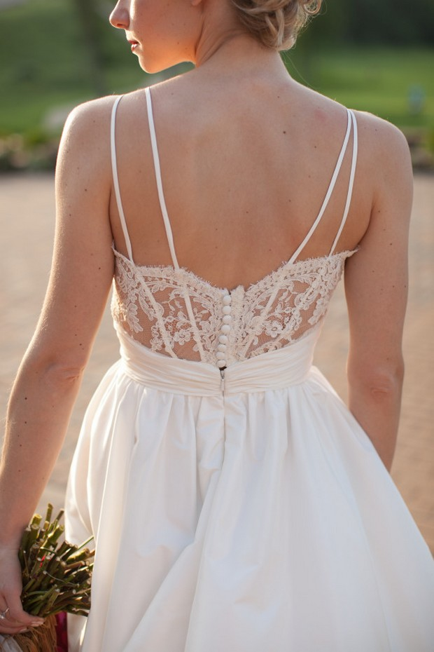 a charming A-line wedding dress with a lace detail and buttons plus straps on the back, pleated full skirt is a lovely idea