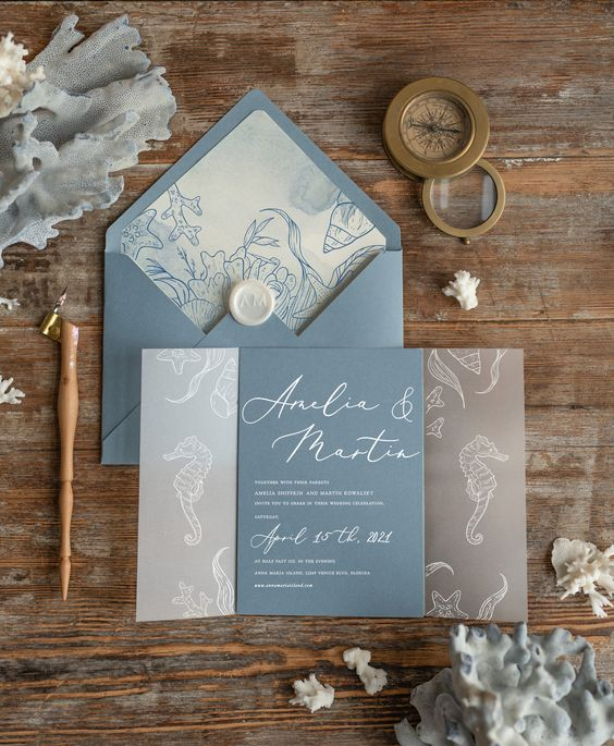 a chic beach wedding invitation suite in blue and grey with sea creature prints is lovely and relaxed