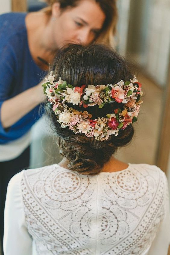 a cool fresh flower halo hairpiece of two parts highlights the romantic low updo