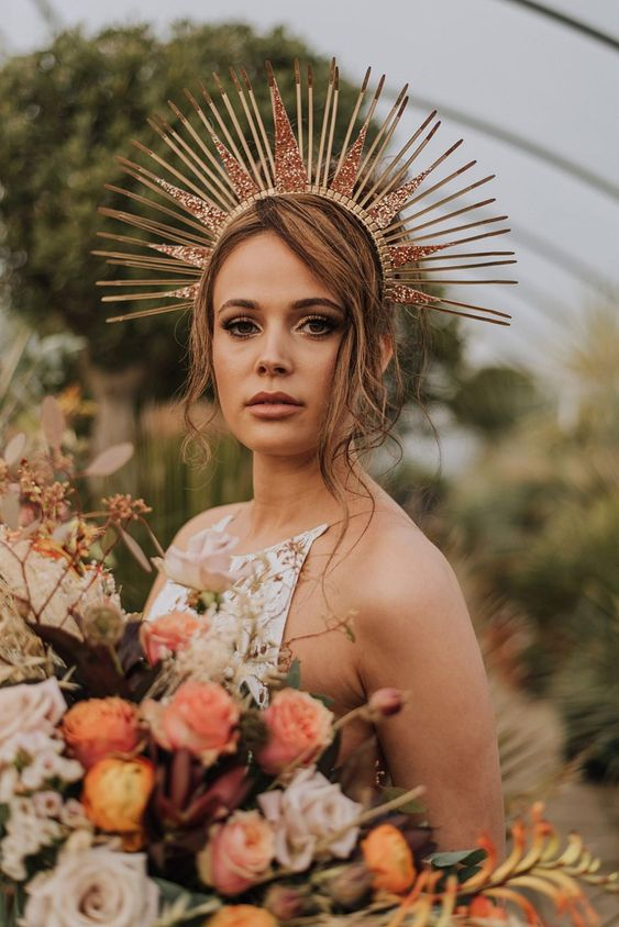 a copper sunburst crown with copper glitter touches is a bold idea for a boho chic bride who loves fashion