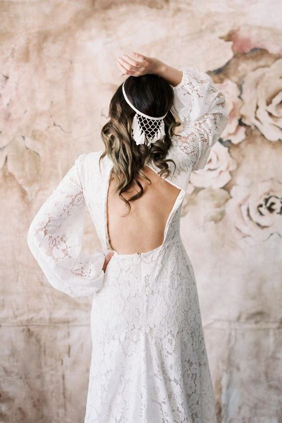a dreamcatcher halo with macrame and tassels in white is a perfect boho chic bridal piece