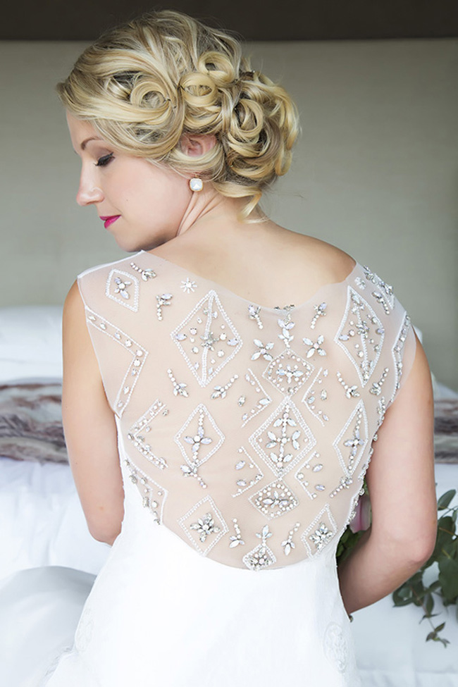 a glam fitting wedding dress with an illusion back detailed with rhinestones forming a geometric pattern is a stunning solution